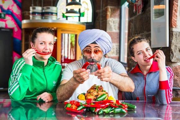 Sammy Bishop, Hardeep Singh Kohli and Weronika Celmer warm up for the Deep Heat Chilli Challenge. Credit: Paul Johnston at CopperMango