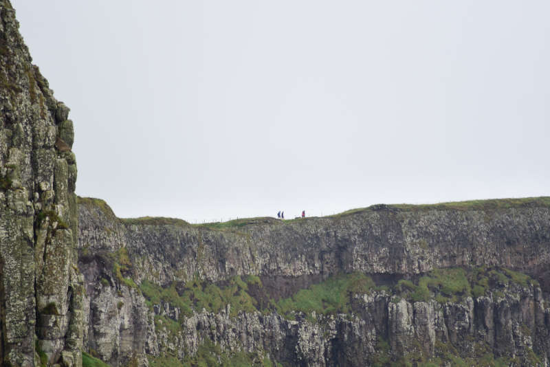 Away a wee walk - small people on a big cliff
