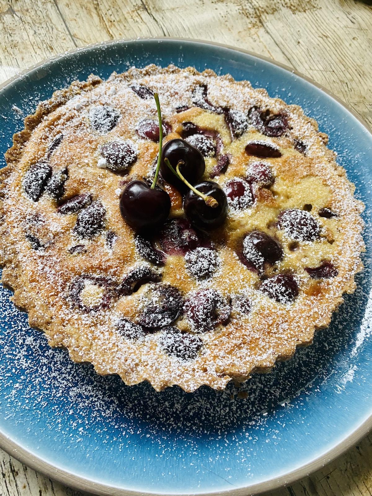 full cherry tart on plate