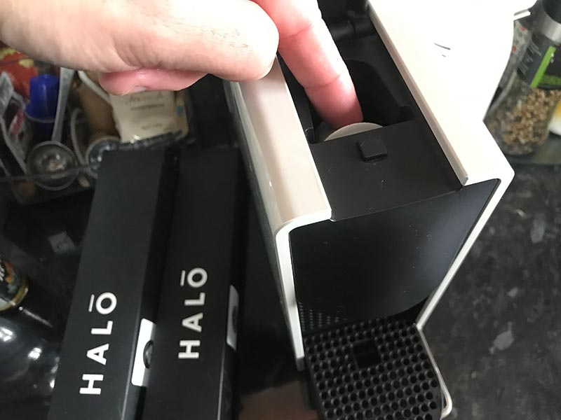 Halo coffee pod being inserted into Nespresso